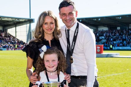 Celebration time for Jack Ross and his family as the Championship title is clinched for St Mirren. Picture: SNS.
