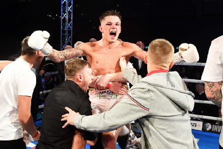 Lee McGregor celebrates with his team after his split decision win over Kash Farooq. Picture: SNS