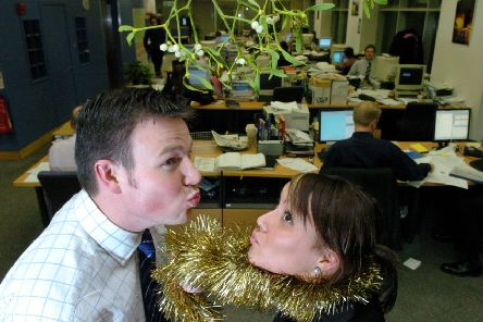 Hang on a minute! Kissing, at the office party? Surely not (Picture: Cate Gillon)