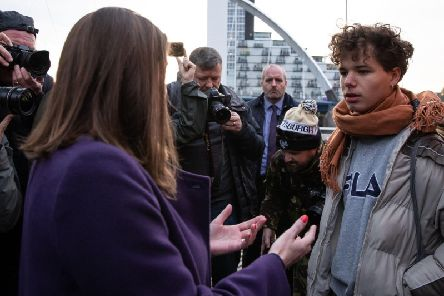 Ms Swinson is confronted by student Jay Sutherland while on the campaign trail in Glasgow.