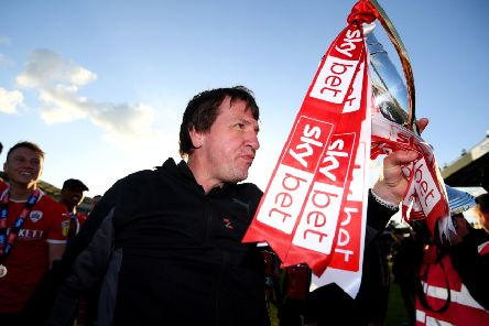 Daniel Stendel celebrates winning promotion to the Championship with Barnsley last season.