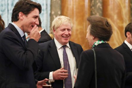 It's not know what they were talking about at this precise moment, but Boris Johnson, Justin Trudeau and Princess Anne seem to have found it rather funny (Picture: Yui Mok/PA Wire)