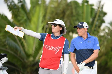 Grant Forrest and his caddie John McClure talk tactics during the first round of the AfrAsia Bank Mauritius Open. Picture: Getty Images