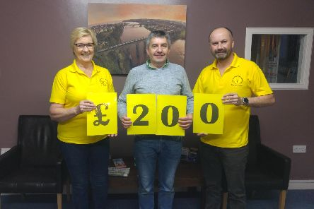 Stephen Scott, centre,handed over the money from the coach company owners to representatives ofBerwick andDistrictCancerSupport Group.