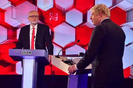 Jeremy Corbyn and Boris Johnson go head to head on Friday's live debate on the BBC. Picture: BBC/Getty