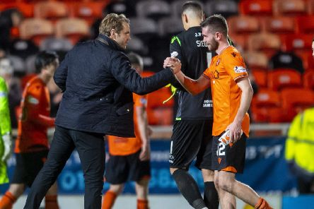 Dundee United manager Robbie Neilson with Sam Stanton at full time. Picture: Bill Murray / SNS