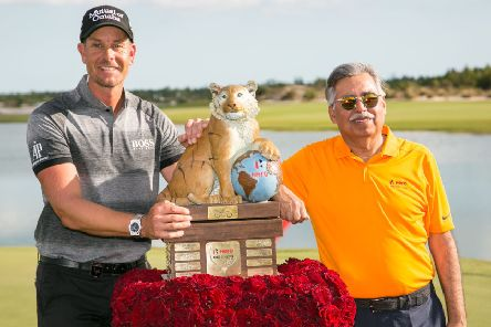 Henrik Stenson, left, poses with the trophy alongside Dr Pawan Munjal, the chairman at Hero MotoCorp, after winning the World Challenge in Nassau.