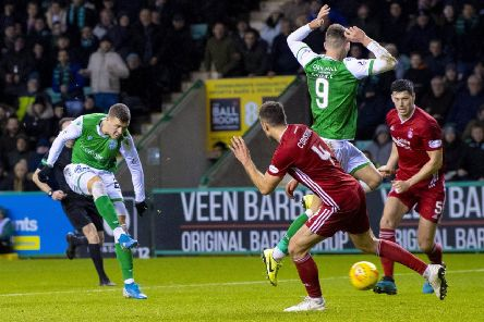 Florian Kamberi fires home Hibs' third goal at Easter Road. Picture: SNS.