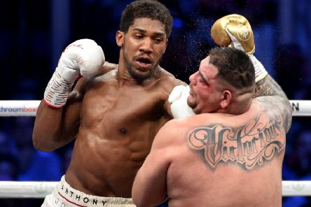 Anthony Joshua lands a left glove on Andy Ruiz Jr in Saudi Arabia. Picture: AFP/Getty