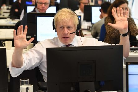 Prime Minister Boris Johnson with other members of the Cabinet at Conservative Campaign Headquarters Call Centre, London, while on the election campaign trail. Picture: PA