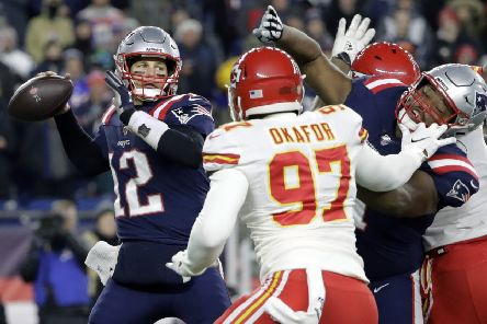 New England Patriots quarterback Tom Brady passes under pressure from the Chiefs' Alex Okafor. Picture: AP.