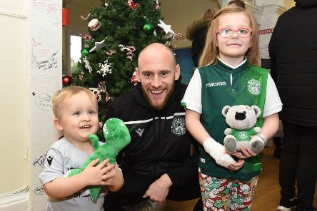 David Gray with Noah Kerr, left, and Cody Douglas during the Hibs squad's visit to the Royal Hospital for Sick Children in Edinburgh. Picture: Paul Devlin/SNS