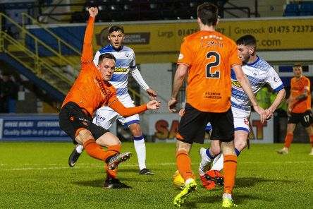 Lawrence Shankland slots the ball home to put Dundee United 2-1 ahead against Morton at Cappielow. Picture: Bruce White/SNS