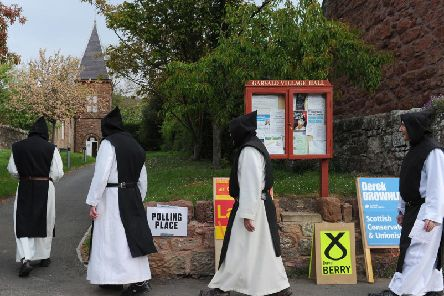Monks from Nunraw Abbey in East Lothian arrive to vote at the village polling station at the 2011 Scottish elections. Just four seats north of the Border are considered safe. Picture: Neil Hanna/TSPL