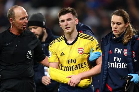 Kieran Tierney is helped off the park after falling awkwardly during Arsenal's Premier League clash with West Ham at the London Stadium