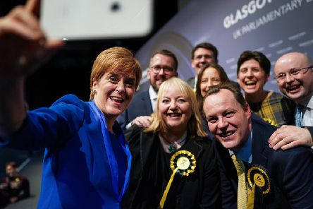 Nicola Sturgeon celebrates with her party. Picture: PA