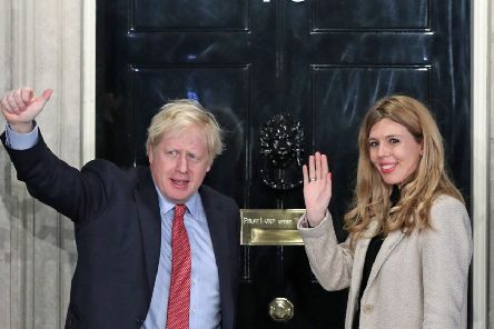 Boris Johnson and his girlfriend Carrie Symonds arrive in Downing Street after the Conservatives' general election victory (Picture: Yui Mok/PA Wire)