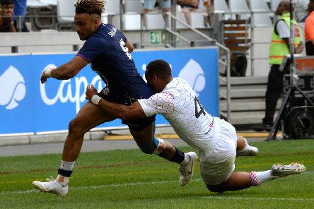 Scotland's Femi Sofolarin escapes the clutches of England's Dan Norton to score the winning try in their Pool C clash at the Cape Town Sevens. Picture: AFP via Getty Images