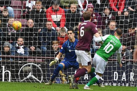 Joel Pereira is beaten by Martin Boyle for the first goal in Boxing Day's Edinburgh derby. Picture: SNS