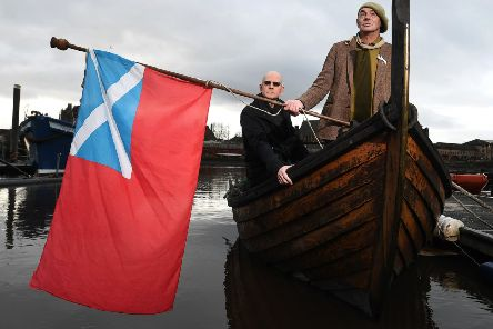 Ian Bogle, right, and Alastair Hart aboard a replica birlinn vessel on the Clyde. Picture: John Devlin