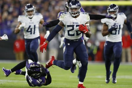 Tennessee Titans running back Derrick Henry skips past Baltimore Ravens strong safety Chuck Clark. Picture: Julio Cortez/AP