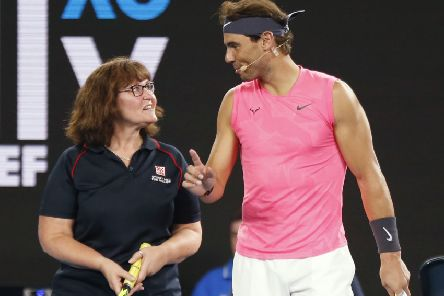 Rafa Nadal gives firefighter Deb some tennis tips at the Rally for Relief Bushfire Appeal event. Picture: Darrian Traynor/Getty
