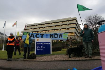 Climate change activists blocked the entrance to the headquarters of oil giant Shell in Aberdeen.