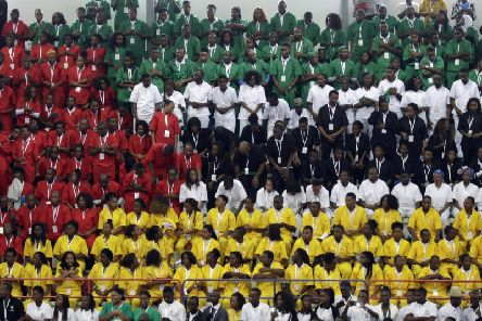 Youths wearing coloured shirts form the flag of Mozambique during an inter-religious meeting. Picture: Associated Press