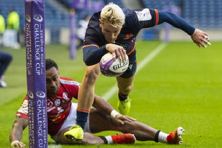 Edinburgh's Darcy Graham runs in for his hat-trick try in the win over Agen at BT Murrayfield. Picture: Paul Devlin / SNS