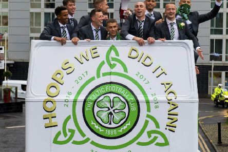 Celtic players celebrate with an open-top bus ride following their victory over Hearts in last season's Scottish Cup final. Picture: SNS.