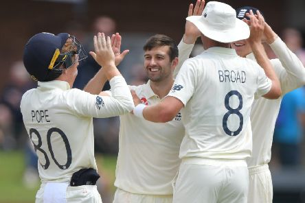 England bowler Mark Wood celebrates with team-mates after Stuart Broad had caught Kagiso Rabada. Picture; Stu Forster/Getty