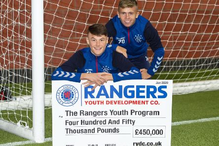 Nathan Patterson, left, and Kai Kennedy with a �450,000 donation for Rangers' youth academy. Picture: Ross MacDonald/SNS