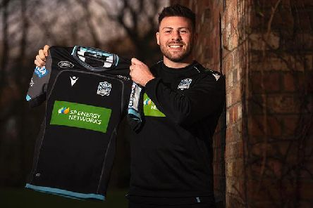 Ali Price celebrates penning a new deal at Glasgow. Picture: SRU/SNS
