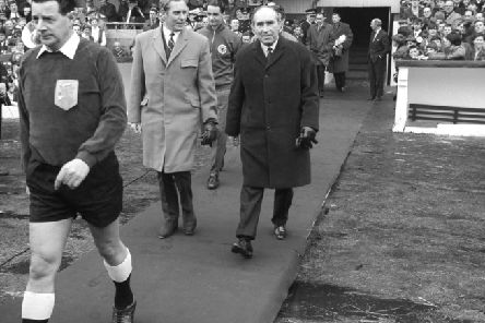 Scotland manager Bobby Brown, left, walks out with England boss Alf Ramsey at Hampden ahead of a European Championship qualifying match in 1968. Picture: PA