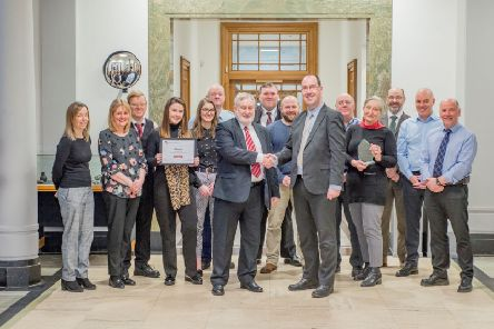 West Lothian Council's Environmental Health team with their award. The Environmental Health team are based in Linlithgow Partnership Centre, where this pic was taken. Picture front are Cllr Tom Conn and Craig Smith, with staff from the council's Environmental Health team.