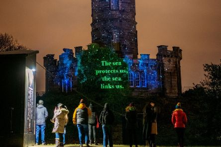 Robin Robertson's text for Message From The Skies is projected onto the Nelson Monument on Calton Hill