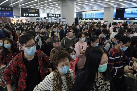 The Chinese Government has effectively locked down Wuhan, cancelling planes and trains there and in the nearby city of Huanggang. Picture: AP
