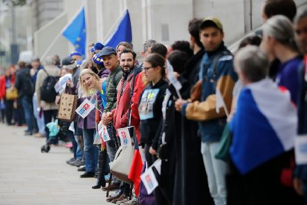 Demonstrators create a human chain from Parliament Square to Downing Street to call on the Government to clarify the position of EU nationals living in the UK after Brexit (Picture: Tolga Akmen/AFP/Getty Images)