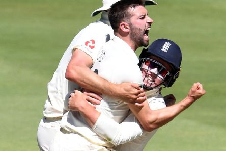 Mark Wood celebrates with Ollie Pope after taking the wicket of Rassie van der Dussen for 98. Picture; Lee Warren/Gallo Images/Getty Images