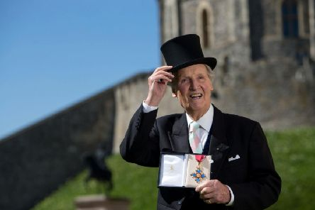 Nicholas Parsons with his CBE, given to him by the Queen in 2014.