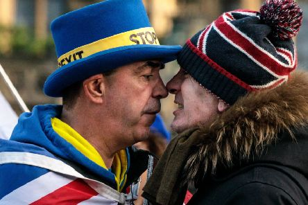 A nation divided: A pro-Brexit and a pro-EU demonstrator get to know each other (Picture: Jack Taylor/Getty Images)