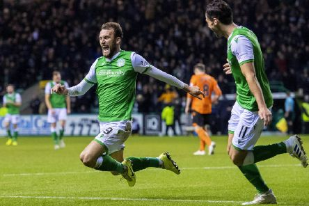Hibs' hat-trick hero Christian Doidge launches himself into a knee slide to celebrate his first goal in last night's 4-2 win over Dundee United at Easter Road last night. Picture: Alan Harvey/SNS