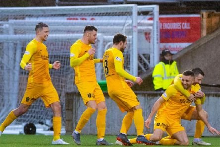 Livingstons Aaron Taylor-Sinclair (R) celebrates his goal with teammates.