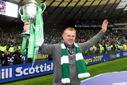 Celtic manager Neil Lennon with the Scottish Cup following victory over Hearts in last year's final. His side will face St Johnstone in this season's quarter-final. Picture: SNS.