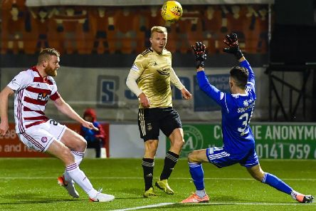 Curtis Main opens the scoring for Aberdeen with a deft chip after 15 minutes in their 3-1 victory at the FOYS Stadium last night. Picture: SNS.