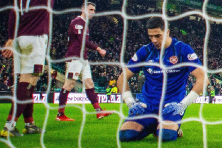 A disconsolate Joel Pereira after conceding a goal in Hearts' 5-0 defeat at Celtic. Picture: SNS
