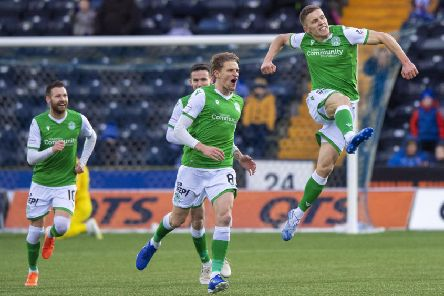 Airborne Greg Docherty celebrates his stunning strike which opened the scoring for Hibs at Kilmarnock. Picture: SNS.