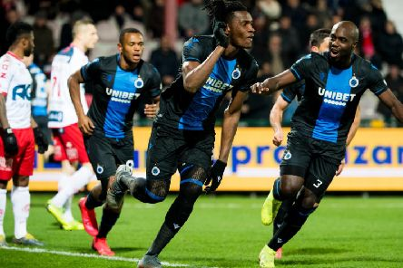 Simon Deli celebrates a goal for Club Brugge against Kortrijk with Eder Balanta