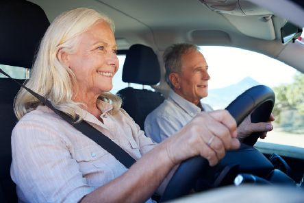 Some couples get on fine with a woman driving, even if this photo is posed by models (Picture: Getty Images/iStockphoto)