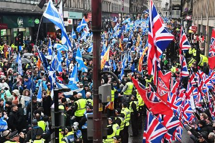 A pro-independence All Under One Banner march passes by unionist supporters in Glasgow (Picture: John Devlin)